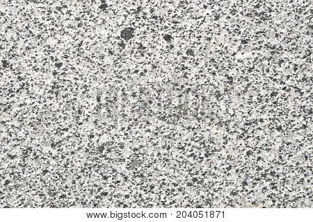Grey granite untreated surface. Facing material full frame horizontal granite texture. Facing material granite texture. Natural stone grey granite background texture. Bright hard grey granite rock texture. Grey granite stone background texture.