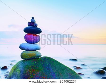 Balanced Stones, Zen Stack In Front Of Smooth Ocean. A Calming View From The Terrace.