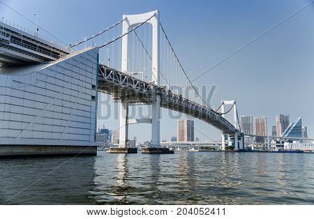 Rainbow Bridge Is A Bridge On Tokyo Bay Between Shibaura Pier And The Odaiba Waterfront. Tokyo, Japa