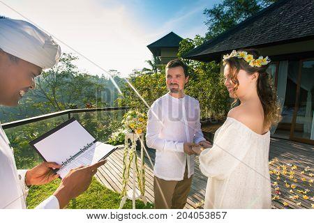 Happy newlyweds couple in marriage, wedding ceremony in Ubud. Wedding proposal
