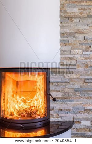 A interior shot of a modern marble fireplace in living room