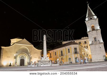 Benevento Italy - 01 Augut 2017: Church of Santa Sofia and its bell tower on the night of August 01 and people walking