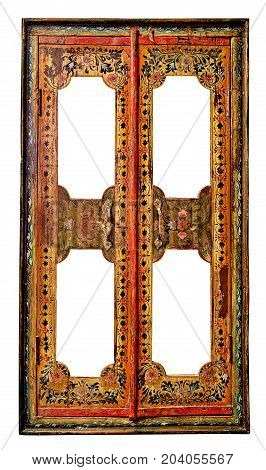 Very old ethnic vintage wooden window with closed shutters isolated on white.