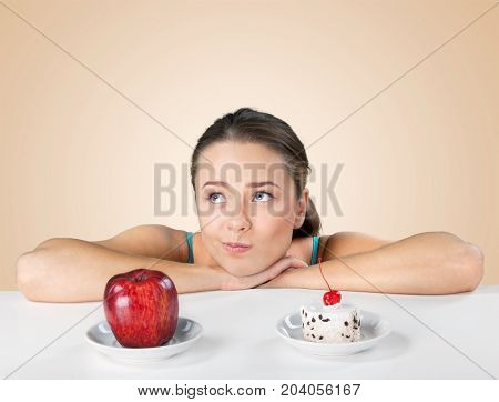 Woman making thoughtful decision young adult red background