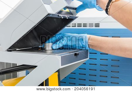 The scientist woman do test on mass spectrometer in chemistry lab