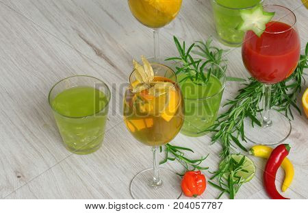 Colorful Cocktails On Wooden Background With Eatable Decorations