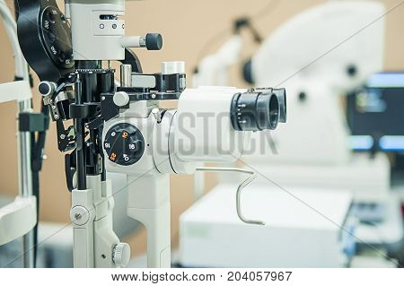 Professional Optometrist Diopter Tool In An Optician Laboratory. Medical And Health Concept. Selecti