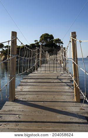 Wooden bridge to Cameo island at Zakynthos Greece