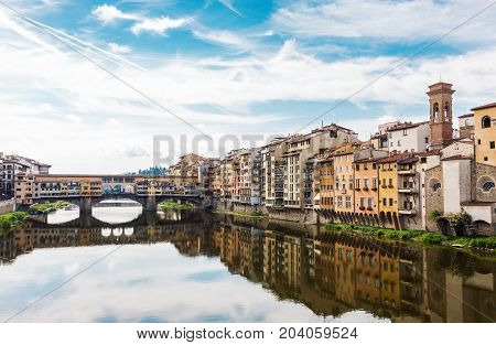 City view of Ponte Vecchio bridge and the Arno River in Florence Italy