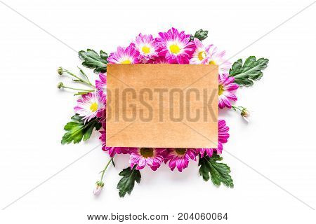 Floral mockup. Sheet of paper in floral frame on white background top view.