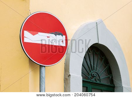 FLORENCE ITALY - JULY 13,2016: Close-up of creative and funny no entry road sign in the center of Florence, Italy