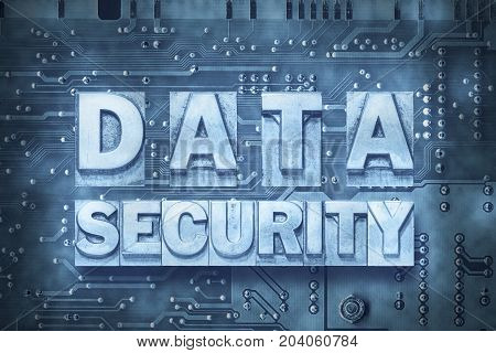 data security phrase made from metallic letterpress blocks on the pc board background