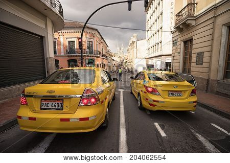 March 2 2017 Quito Ecuador: yellow taxis waiting at a traffic light in the capital city