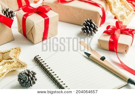Close Up List Of Gifts For Christmas. Drawing Up A List Of Gifts. Presents In Kraft Paper Vintage Wh