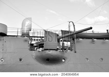 Gun of Aurora cruiser in Saint Petersburg Russia. Black and white.