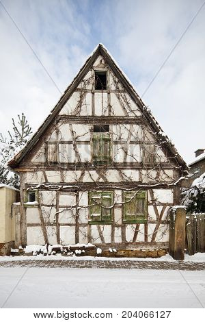 Overgrown Half-timbered House In Village, Germany