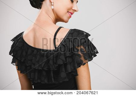 close up portraite of young pretty woman in black and transparent dress in studio, nice dancer dancing backwards