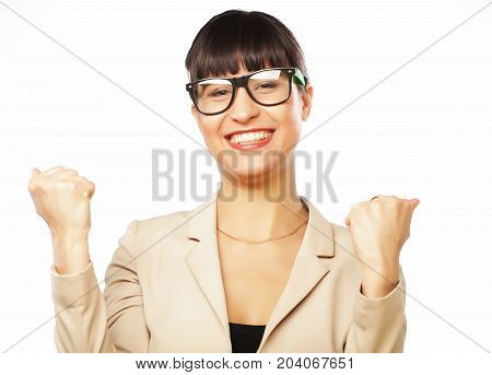 Successful business woman with arms up celebrating isolated on white