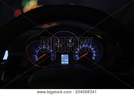 speed Meter Console Car of car stopping beside the road at night