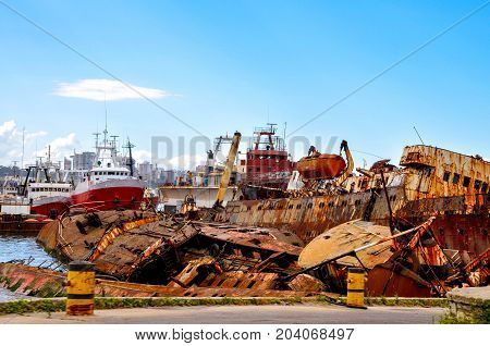 Shipwrecks and boats in a harbor in Argentina