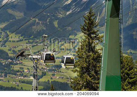Schladming, Austria - August 15: Tourists Travel In Cable Car To Planai Bike And Ski Areal On August