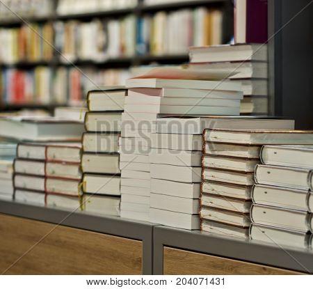 big pile of books in a bookstore