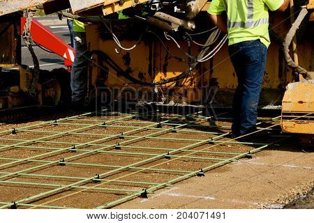 The process, machine, and labor required to lay concrete in the forming of a new sidewalk