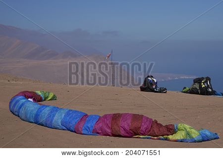 Iquique, Tarapaca Region, Chile - August 20, 2017: Paraglider on the launch site above the coastal city of Iquique on the northern coast of Chile.