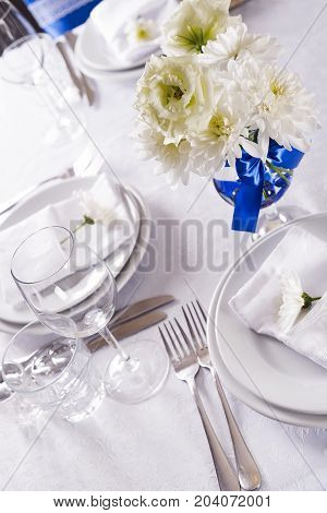 Festive table setting, serving, festive atmosphere, cutlery, serving with flowers Valentine's Day, Mother's Day, Women's Day.