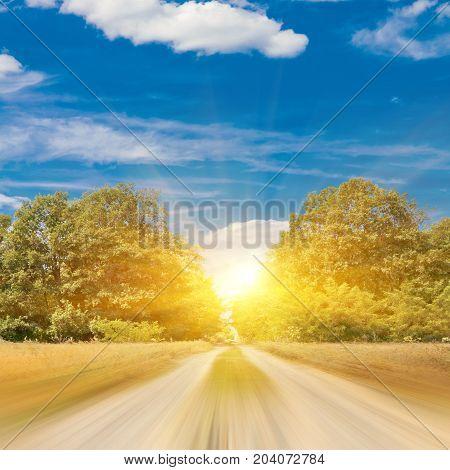 Blurred road. Non-urban summer landscape nature background