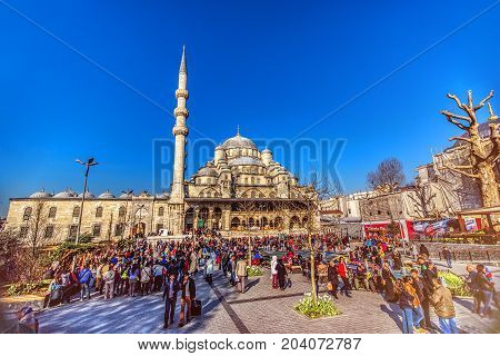 ISTANBUL TURKEY: Square in front of the Yeni Mosque New Mosque or Mosque of the Valide Sultan on April 11 2015