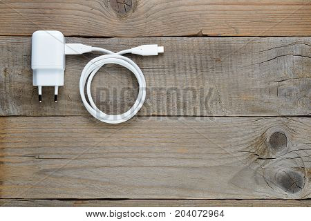 Smartphone or tablet charger on wooden table