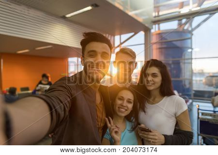 Young People Group In Airport Lounge Waiting Departure Happy Smile Mix Race Friends Taking Selfie Photo Flight
