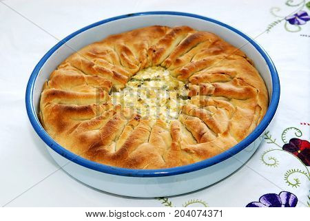 Delicious traditional pie with spinach and cheese in casserole dish