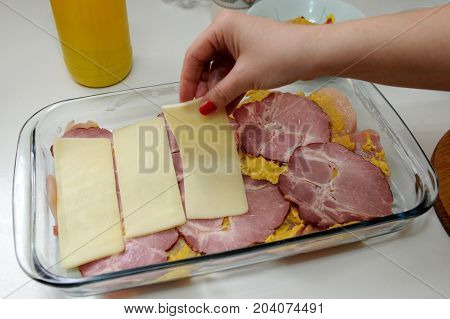 Preparing meal specialty with smoked ham and cheese