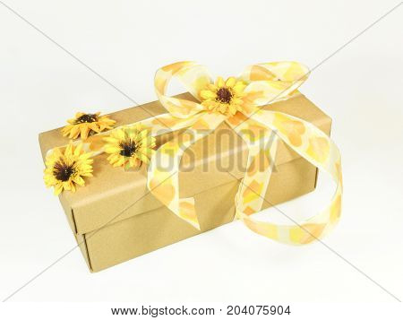 Decorative wrappage of gift box adorned with flowers and bow