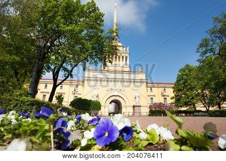Facade of the Admiralty building tower with spire and golden sail warship at sunny day