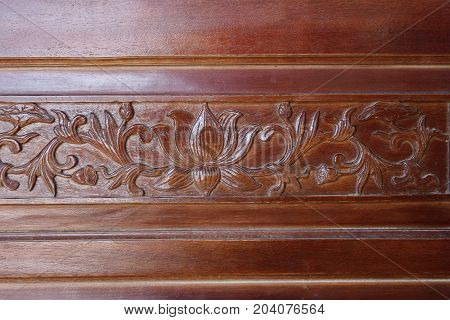 Save Download Preview Closeup a beautiful lotus wooden carved door