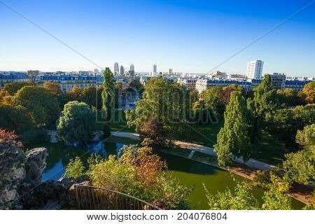 Top view picture of beautiful cityscape of nineteenth district of Paris from Buttes Chaumont park