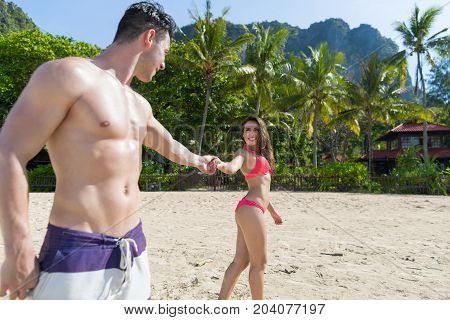 Couple On Beach Summer Vacation, Young People In Love Walking, Man Woman Holding Hands Sea Ocean Resort Holiday Travel