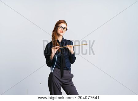 A nice smiling teacher with a pointer and a school magazine on a white background,folder