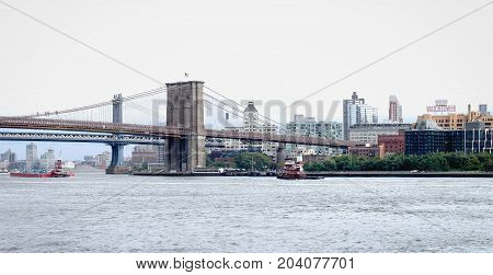 New York USA - 28 September 2016: View of the Brooklyn Bridge and waterfront buildings in Brooklyn from the East River.