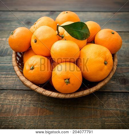 Mandarin on wooden background. Flat lay, top view