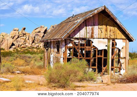 Forgotten landscape including an abandoned collapsing house taken in the rural Mojave Desert, CA