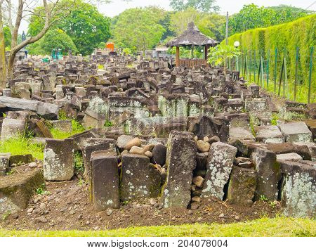 Close up of pile of rocks outside of Prambanan temple near Yogyakarta on Java island Indonesia.