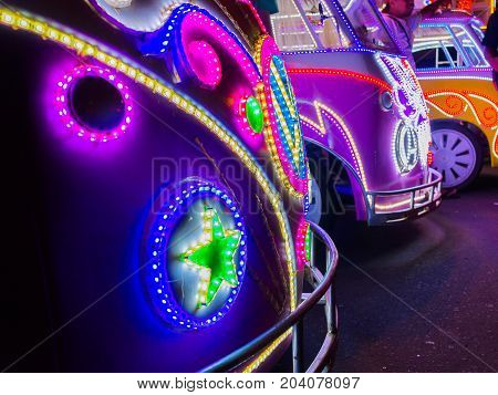 JOGJA, INDONESIA - AUGUST 12, 2O17: Close up of a traditional pedicap transport parket at outdoor with colorful and bright lights at night at jogja Yogyakarta Indonesia.