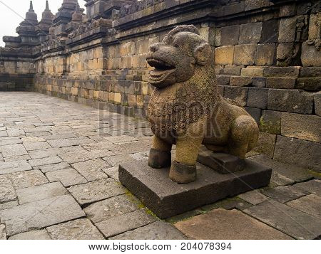 JOGJA, INDONESIA - AUGUST 12, 2O17: Lion Sculpture guarding the stair entrance to the top of Borobudur, Central Java, Indonesia.