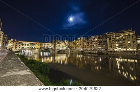 Night view of Ponte Vecchio in Florence on a night with full moon