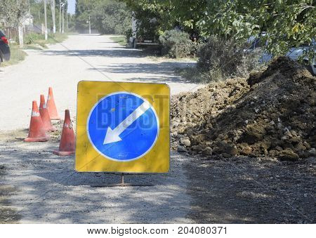 Sign Of Detour Travel. Pit On The Road. Repair Work.