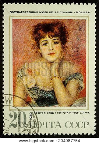 Moscow Russia - September 14 2017: A stamp printed in USSR shows portrait of actress Jeanne Samary by Pierre-Auguste Renoir (1841-1919) series